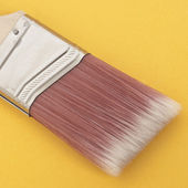 Close Up of a Paint Brush on a Vibrant Background — Stock Photo