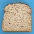 Slice of Whole Grain Bread on Vibrant Blue — Stock Photo #4165636