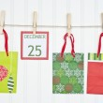 Gift Sack and Christmas Calendar Page on a Clothesline — Stock Photo
