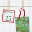 Gift Sack and Christmas Calendar Page on a Clothesline — Stock Photo