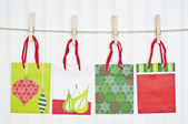 Holiday Gift Bags on a Clothesline — Stock Photo