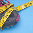 Running Shoe With Measuring Tape - Stock Photo