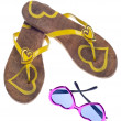 Yellow Flip Flop Sandals with Hearts and Sunglasses — Stock Photo