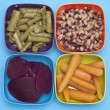 Carrots, Beets, Asparagus and Black Eyed Peas in Colorful Bowls. — Stock Photo