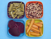 Carrots, Beets, Asparagus and Black Eyed Peas in Colorful Bowls. — Stock fotografie