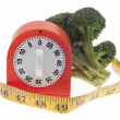 Foto Stock: Health and Diet Concept with Broccoli and Timer Clock