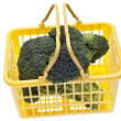 Fresh Broccoli in a Yellow Shopping Basket — Stock Photo