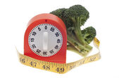 Health and Diet Concept with Broccoli and Timer Clock — Stock Photo