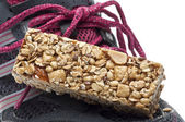 Energy Bar and Sneaker Shoe Sports Nutrition Concept — Stock Photo
