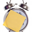 Stock Photo: Clock with Blank Note