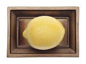 Fresh Lemon in a Yellow Dish — Stock Photo