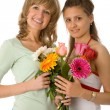 Two women with flowers — Stock Photo