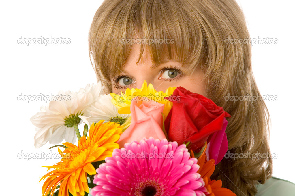 The young woman with flowers on white background — Stock Photo #4496157