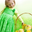 Little beautiful girl with flowers — Stock Photo