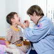 Stock Photo: Doctor of ambulance and sick child
