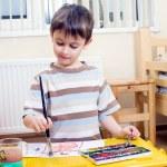 Painting boy — Stock Photo