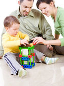 Child is building a house with patents — Stock Photo