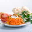 Carrot salad with tomato and parsley — Stock Photo