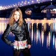 Night portrait of the beautiful girl against the bridge — Foto Stock
