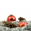 Garland with pine cones and baubles — Stock Photo
