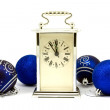 Stock Photo: Clock showing five minutes to New Year
