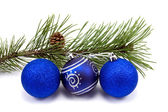 Pine branch and christmas baubles — Stock Photo