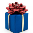 Blue gift box with red bow — Stock Photo