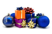 Blue christmas baubles and gifts — Stock Photo
