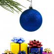 Christmas bauble and gifts — Stock Photo