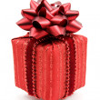 Red gift box with  bow — Stock Photo
