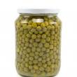 Glass jar of preserved peas — Stock Photo