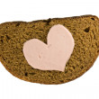Bread and heart shaped sausage — Stock Photo