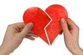 Male and female holding broken heart — Stock Photo