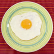Green plate with cooked egg — Stock Photo