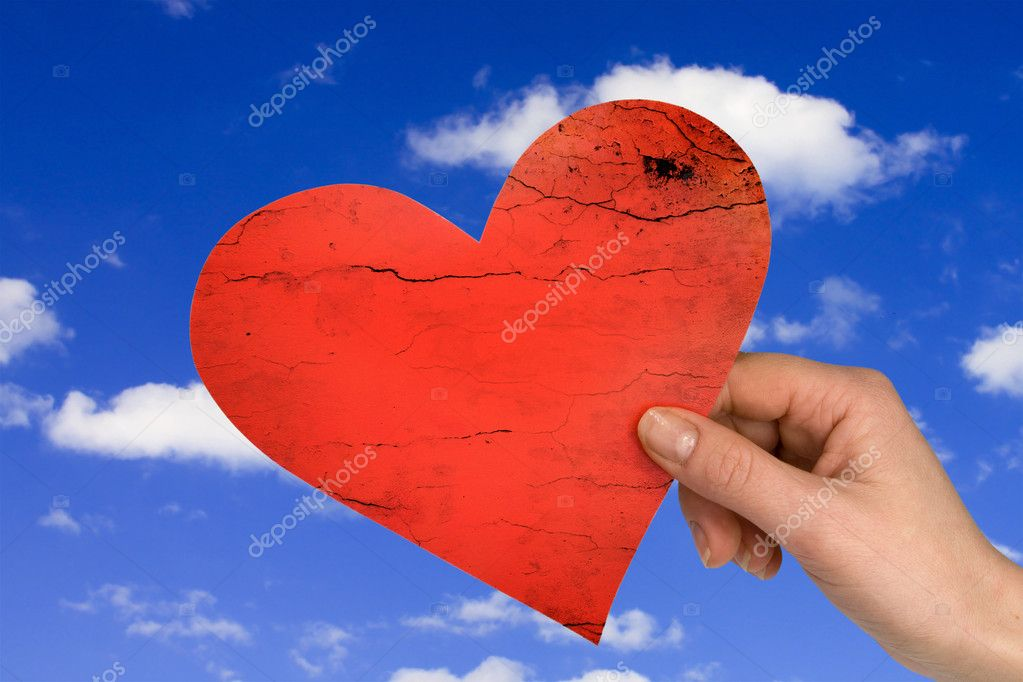Love concept. hand with heart on sky background  Stock Photo #4784483
