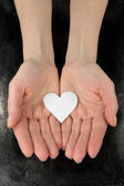Paper heart in a hands — Stock Photo
