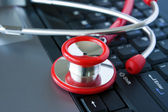 Stethoscope on a computer keyboard — Stock Photo