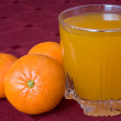 Mandarines and glass of juice — Stock Photo