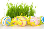 Ornate easter eggs with grass — Stock Photo