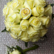 Stock Photo: Two rings on bouquet of roses