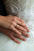Hands of newlyweds — Stock Photo