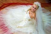 Bride sitting on the floor — Stock Photo