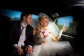 Newlyweds in the limo — Stock Photo
