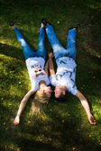 Boy and girl lying on the grass. — Stock Photo