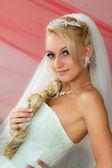 Bride keeps hair — Stock Photo