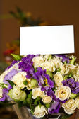 A bouquet of roses with a white card — Stock Photo