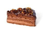 Stuk van chocolade taart met walnoten. — Stockfoto