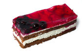 Piece of cake with cherry and strawberry. — Stock Photo