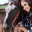 Cute cowgirl on ranch - Stock Photo