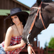 Cute cowgirl on ranch — Stock Photo #4020513